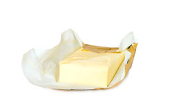 Yellow butter with paper package Royalty Free Stock Photo