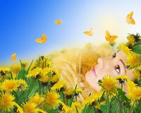yellow butterflies and woman lying on meadow royalty free stock photos