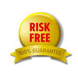 Yellow button with words `Risk Free - 100% guarantee` Royalty Free Stock Photography