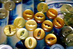 Yellow buttons. Assorted yellow buttons against a blue background royalty free stock photo