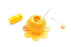 Yellow buttons, pins and thread Stock Images
