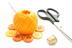 Yellow buttons, scissors, thimble and thread Royalty Free Stock Photos