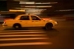Yellow cab. Speeding in the night Stock Photography