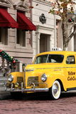 Yellow cab. A beautiful old yellow cab standing in the streets of a city in the USA waiting to be driven around by its proud owner Stock Photos