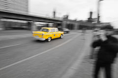 Yellow cab on black and white. Yellow cab in motion blur driving on a city street. The picture is processed in black and white except the yellow cab. It was Stock Images