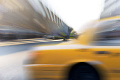 Yellow cab in blurred motion Stock Photography