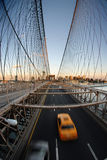 Yellow cab on Brooklyn bridge. A top down view of the New York Brooklyn bridge roadway and a speeding yellow cab below Stock Photos