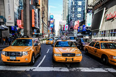 Yellow cab and busy Time Square Royalty Free Stock Images