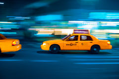 Yellow cab at the crossroads. Stock Images
