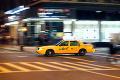 Yellow cab at the crossroads. Royalty Free Stock Image
