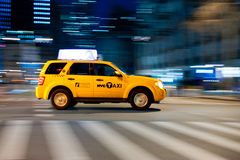Yellow cab at the crossroads. Royalty Free Stock Images