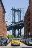 Yellow cab in Dumbo of New York City. New York, USA - May 26, 2018: Yellow cab on a street in Dumbo of New York City. It is a major attraction in New York with stock photography