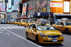Yellow cab passing through times square. A shot of a cab passing by times square area in new york city, usa Royalty Free Stock Photography