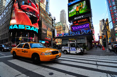 Yellow cab passing through times square Stock Photos