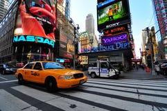Yellow cab passing through times square. A shot of a cab passing by times square area in new york city usa Stock Photos