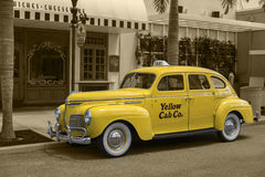 Yellow Cab. Photograph in Universal Studios, Orlando, Fla. A Yellow Cab outside a Hollywood diner of the 40s Stock Photo