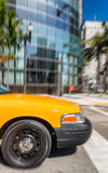 Yellow cab speeding up along city streets Stock Photography