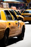 Yellow cab speeds through Times Square in New York. Royalty Free Stock Photography