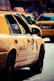 Yellow cab speeds through Times Square in New York. Royalty Free Stock Photos