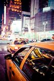 Yellow cab speeds through Times Square in New York. Yellow cab speeds through Times Square in New York, NY, USA royalty free stock photo
