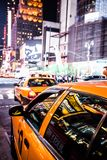 Yellow cab speeds through Times Square in New York. Stock Images