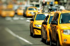 Yellow cab speeds through Times Square in New York, NY, USA. Stock Images