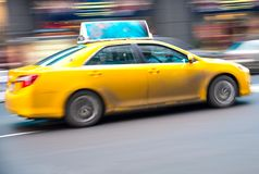 Yellow cab on the street Royalty Free Stock Photo