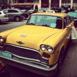 Yellow cab on the streets of Vienna, Austria. Royalty Free Stock Photography