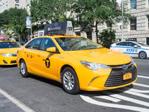 Yellow cab at 5th avenue in New York City Royalty Free Stock Photo