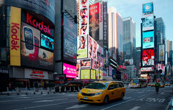 Yellow Cab at Times Square. NEW YORK CITY - JANUARY 13: Times Square, featured with Broadway Theatres and animated LED signs, is a one of the main tourist stock photos