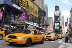 Yellow Cab in Times Square, New York City. Ford Crown Victoria Yellow Cab in Times Square, New York City, USA royalty free stock photos