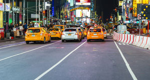 Yellow cab in Times Square Stock Photos