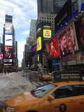 A Yellow Cab on Times Square in Snow in Winter. Royalty Free Stock Photos