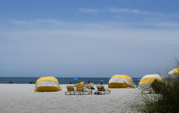 Yellow cabanas and chairs on beach Stock Photo