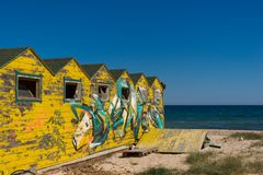 Yellow cabins. Vintage yellow summer cabins on a beach Royalty Free Stock Photo