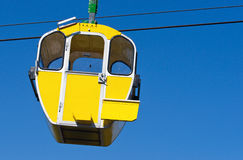 Yellow cable car or gondola Stock Photos