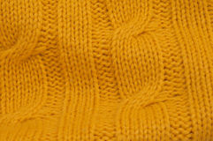 Yellow cable stitch pattern. Close up of yellow cable stitch knitting pattern Royalty Free Stock Images