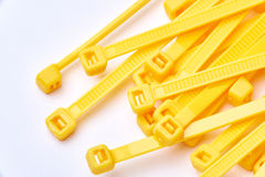 Yellow cable ties. Commercial photo on white background. royalty free stock photos