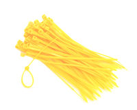 Yellow cable ties isolated against white background Royalty Free Stock Photo