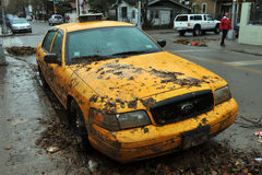 Yellow cabs all in mud in the Sheepsheadbay. BROOKLYN, NY - OCTOBER 29: Yellow cabs all in mud in the Sheepsheadbay neighborhood due to flooding from Hurricane Stock Image