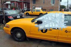 Yellow cabs all in mud in the Sheepsheadbay. BROOKLYN, NY - OCTOBER 29: Yellow cabs with broken windows in the Sheepsheadbay neighborhood due to flooding from Stock Image