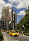 Yellow cabs and Empire State stock photo