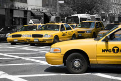 Yellow cabs in a monochrome world. Shot of yellow cabs with all surroundings in monochrome Stock Photography