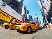 Yellow cabs and neon lights at Times Square in New York City Royalty Free Stock Images