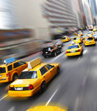 Yellow cabs in New York. NYC yellow cabs / taxis on busy New York street Stock Photography