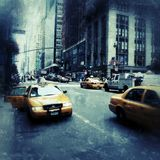 Yellow cabs in New York City grunge style. Typical yellow cabs on the streets of New York City Royalty Free Stock Image