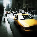 Yellow cabs in New York City grunge style. Typical yellow cabs on the streets of New York City Stock Image