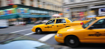 Yellow cabs during rush hour. A panning shot of a yellow cab in manhattan Stock Photography