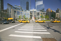 Yellow cabs and taxies speed by Columbus Circle, Manhattan, New York City, New York Stock Photography