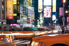 Yellow cabs at Times Square. A night shot of times square with light streaks royalty free stock images